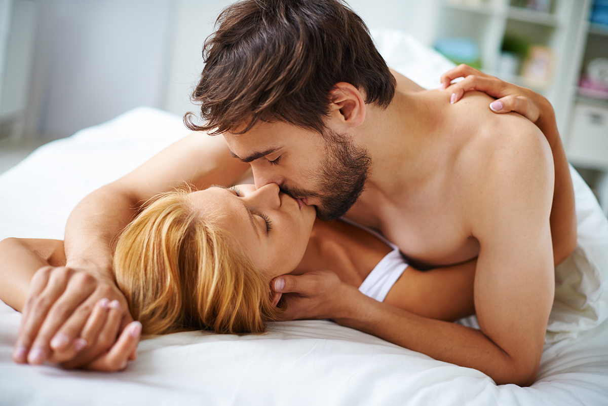 Couple kissing in bed 1200.jpg